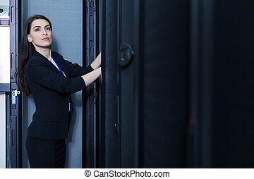 Nice professional technician checking the communication server