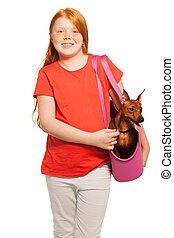 Nice red girl carry dog pet in purse