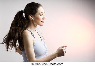 nice running girl - young nice running girl listens too...