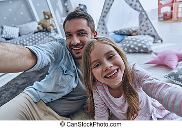 Nice selfie! Self portrait of young father and his little...