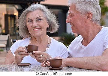 senior couple with coffee