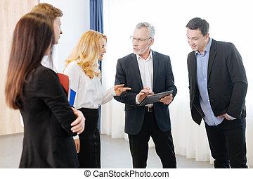 Nice senior man holding a tablet