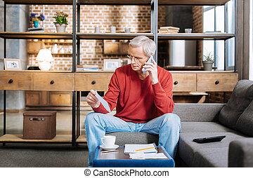 Nice serious man making a call