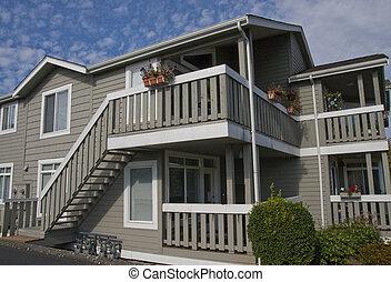 A nice small condominium unit with wood siding