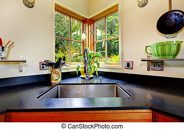 Nice sink with black counter top. - Nice sink in middle of...