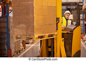 Nice smart man working in the storehouse