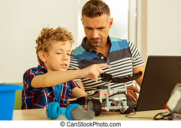 Nice smart young boy studying information technology