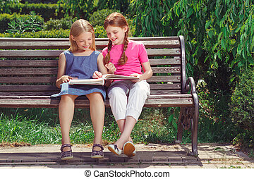 Nice smiling children sitting on the bench