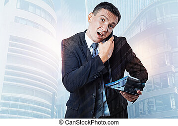 Nice stressed out businessman holding receiver