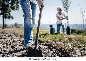 Nice strong man digging