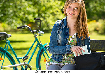 Nice student girl sitting in the park