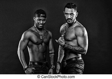 Nice tattoo, men. Muscular men with fashionable tattoo style. Sexy men with muscular torso. Brutal macho style. Sexy and attractive, black and white