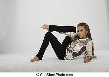 nice teenage girl dancing in studio