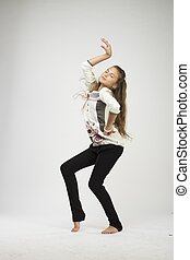 nice teenage girl dancing in studio