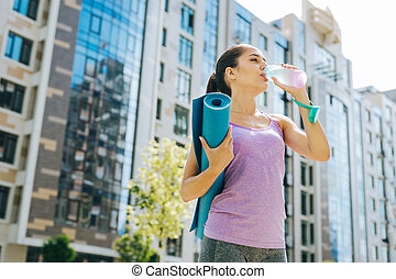Nice thirsty woman drinking