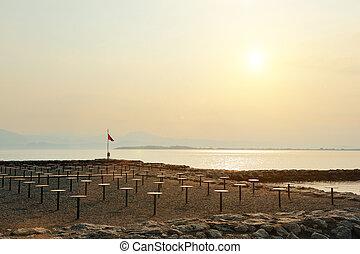 nice view of a beach on Lake Garda at sunset