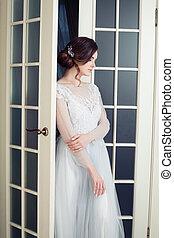 Nice woman fashion model in white dress. Beautiful bride portrait