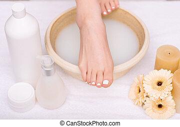 Nice woman having foot treatment
