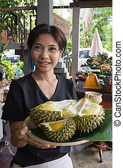 Nice Woman holding Durian tray