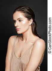 Nice woman model on black background