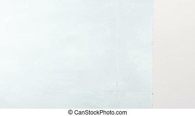 Nice woman peeking from behind wall