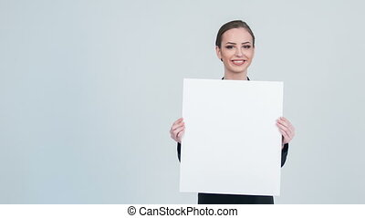 Nice woman putting up white piece of paper