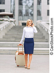 Nice woman standing near office building - Self-sufficient ...
