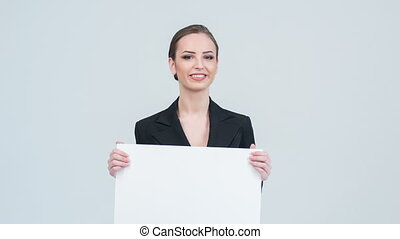 Showing work. Lady in suit with white piece of paper