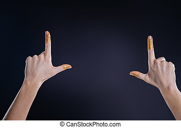 Nice womans hands gesturing against black background