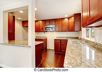 Nice wooden kitchen room interior with granite counter tops