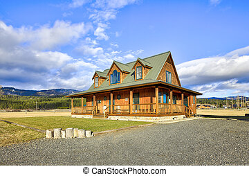 Nice wooden ranch home with beautiful landscape in the countryside.