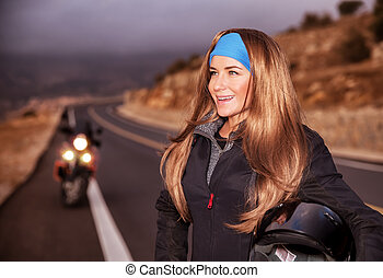 Nice young biker on the road