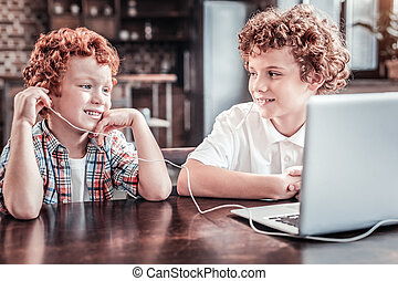 Nice young boy wearing headphones