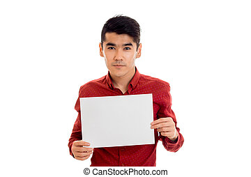nice young brunette man in red t-shirt with placcard in his hands isolated on white background
