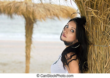 Nice young brunette on a beach
