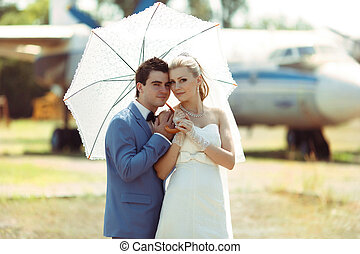 Nice young couple in the sunny wedding day