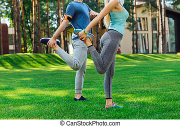 Nice young people doing a stretching exercise