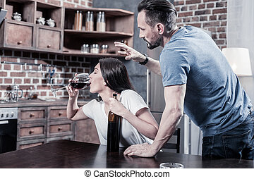 Nice young woman drinking wine