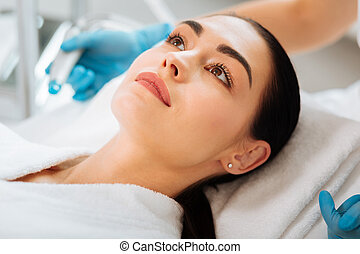 Nice young woman having a beauty procedure