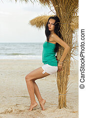 Nice young woman on a beach