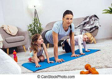 Nice young woman preparing to do pushups