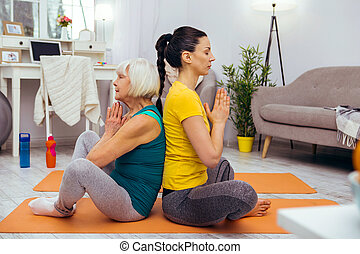 Nice young woman sitting in a lotus pose