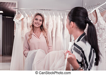 Nice young women having fun in the wedding shop - Happy...