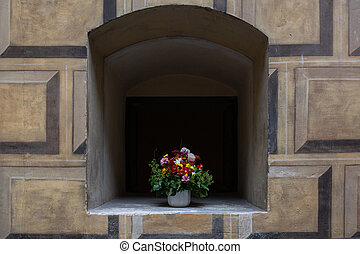 Niche in the wall with flowers