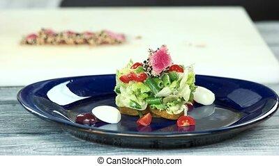 Nicoise salad preparation. Seared tuna and vegetables.