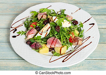 Nicoise salad with roasted tuna and boiled egg. Closeup view