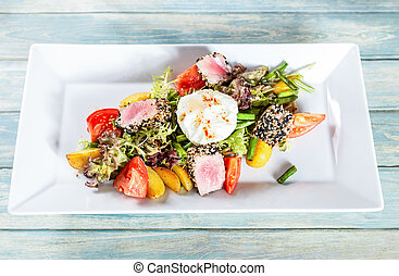 Nicoise salad with roasted tuna and poached egg