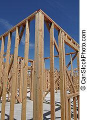 nieuw huis, in aanbouw, dichtbegroeid boven