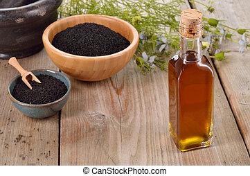 Nigella sativa oil. - Nigella sativa oil in a bottle and ...