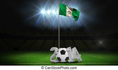 Nigeria national flag waving on pole with 2014 message on football pitch